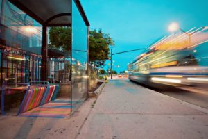 A bus caught during movement causing motion blur in the image