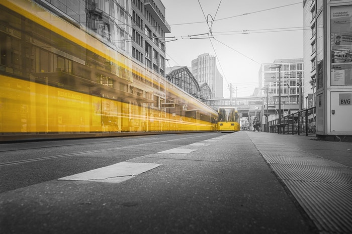 A yellow tram with motion blur