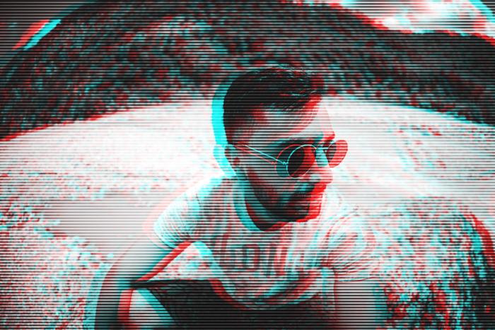 Foto do efeito glitch de um homem usando óculos escuros