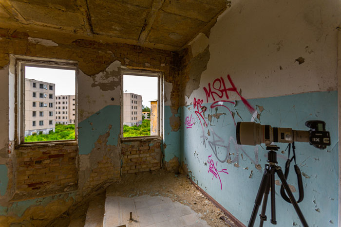A DSLR fitted with V860II flash with the X1T radio trigger on a tripod in an abandoned building
