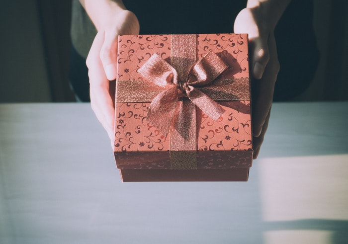 A person holding a gift box