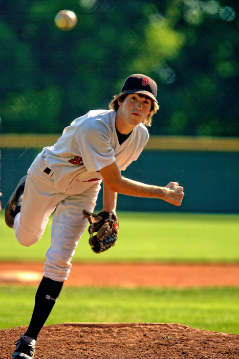 An action shot of a man playing baseball