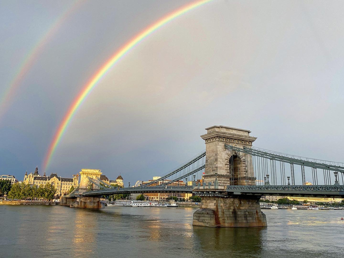 Double rainbow over a bridge in Budapest