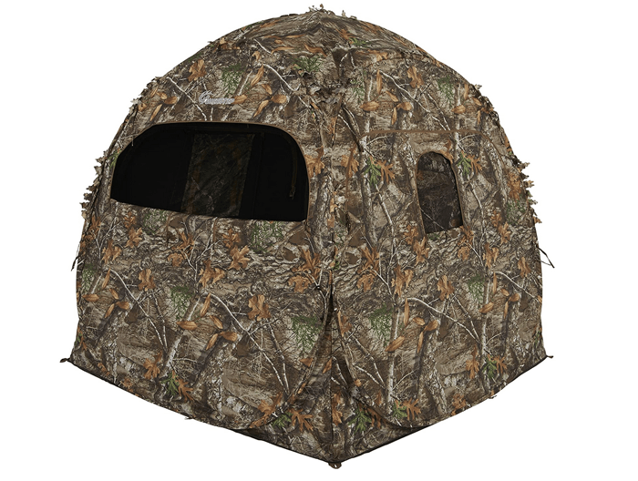 A camouflaged bird blind tent