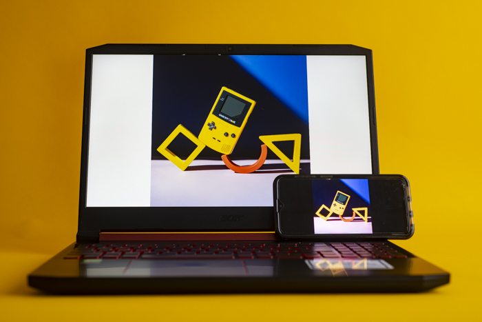 A laptop and phone with the same image on each screen
