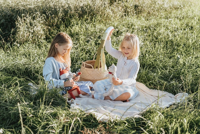 Portrait of two little girls playing with toys