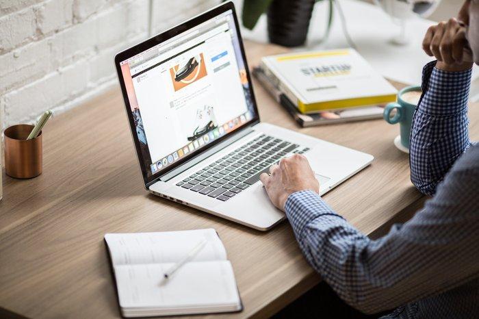 Man using a laptop at an office desk