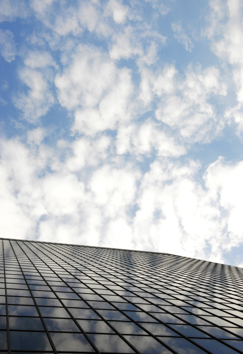 Reflection of clouds on highrise window