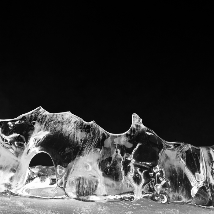 Black white photography of frozen water and air bubbles.