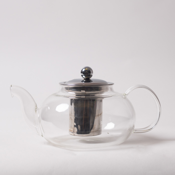 teapot made from glass and metal reflective surfaces