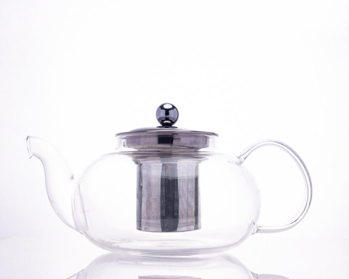 teapot with black stripe down metal surface