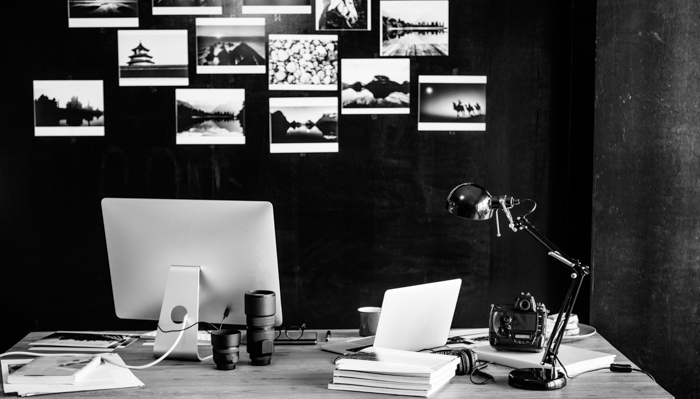a black and white image of a photographers work station