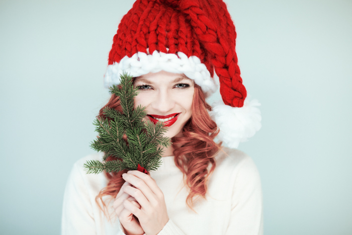 Christmas portrait of a woman in a Santa hat