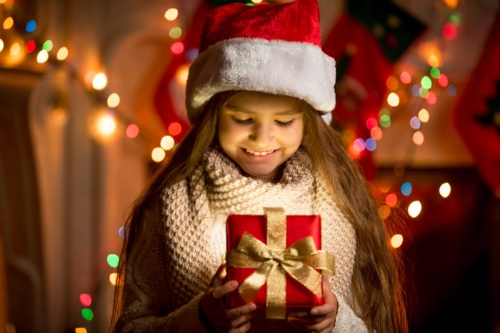 Festive portrait of a little girl in a Santa hat
