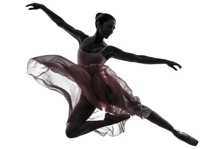 an action shot of a ballerina in flight