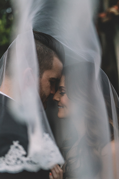 Close up wedding portrait of the couple embracing