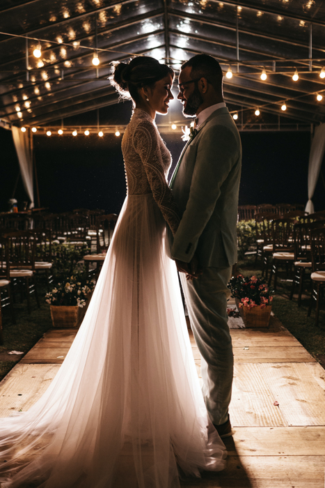 Atmospheric wedding portrait of the couple embracing