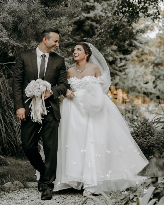 Wedding portrait of the couple walking outdoors