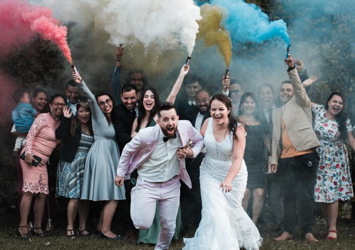 Fun wedding photography group shot with smoke bombs