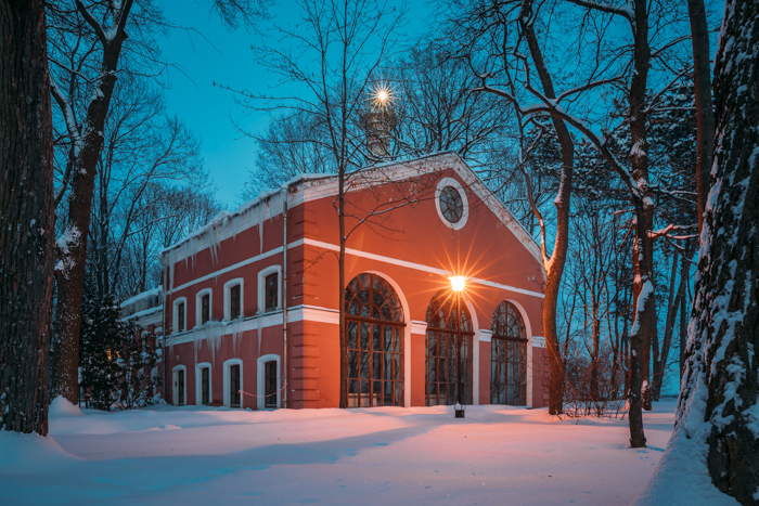 A building covered in snow on a winter evening