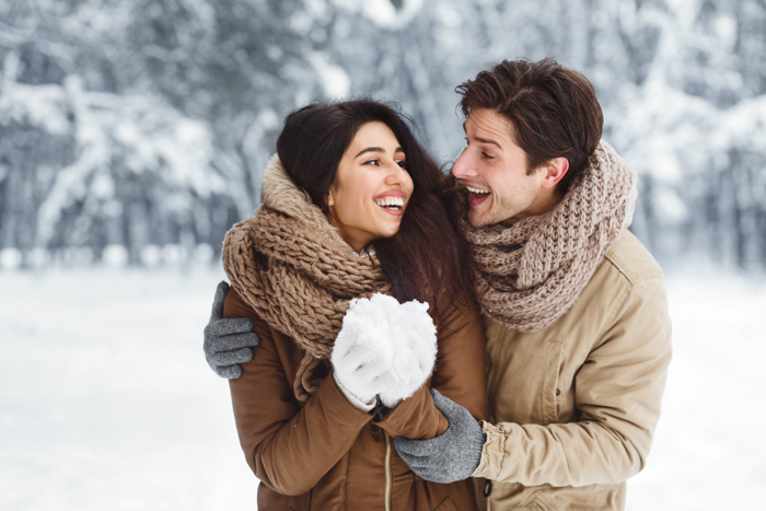 A couple posing in the snow