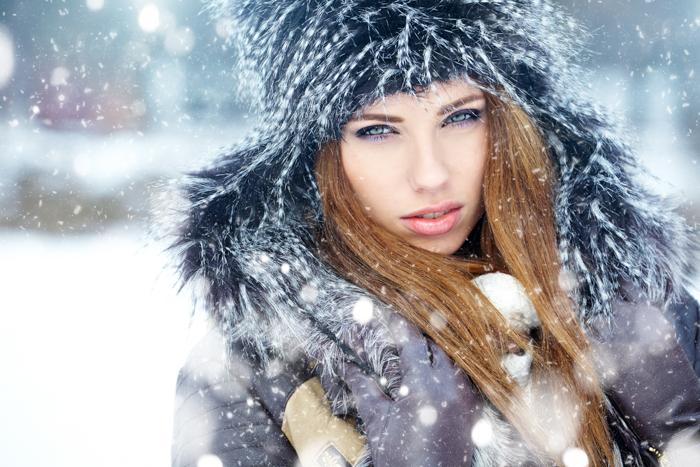 Winter portrait of a female model in the snow
