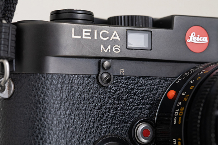 A photography of Leica M6 featuring the logo
