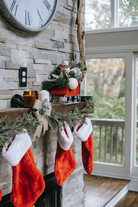 Christmas card photo of stockings hanging by a fireplace