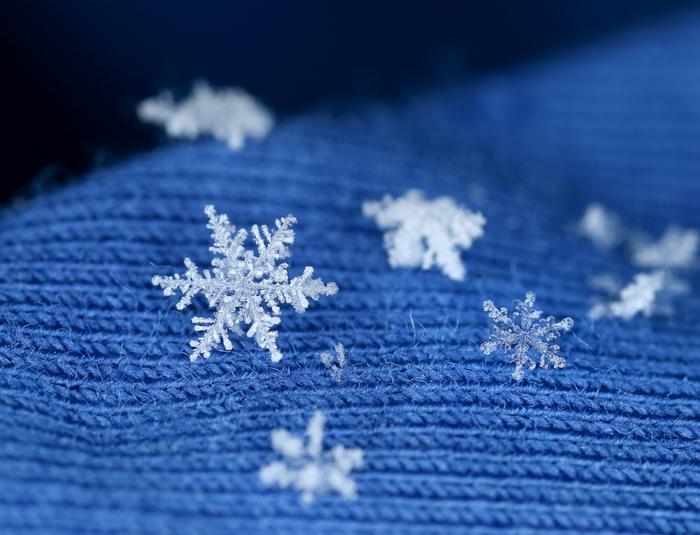 Macro closeup of snowflake crystals in bokeh.