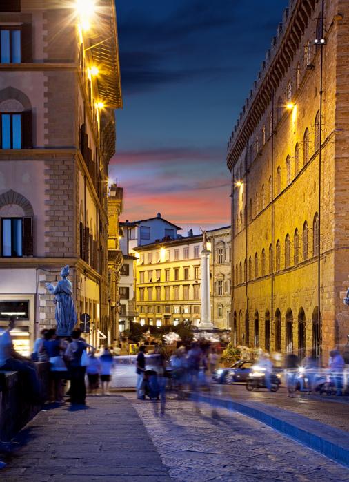 A busy street scene in low light