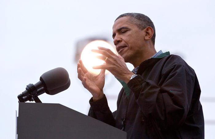 Barack Obama holding a ball of light