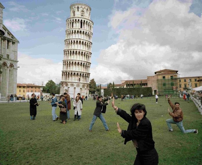 Joke image of people failing to hold up the leaning tower of pisa