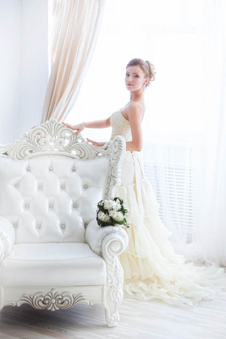 Image of a bride with curtain