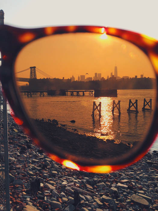 A pretty coastal photo photographed through the lens of a pair of sunglasses