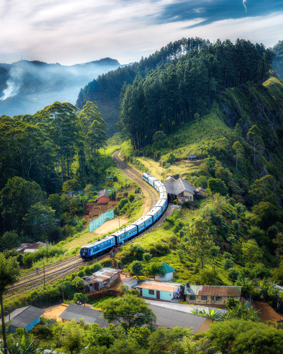 Travel photo of a train moving through a serene landscape