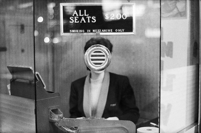 Woman at the cashier by Joel Meyerowitz