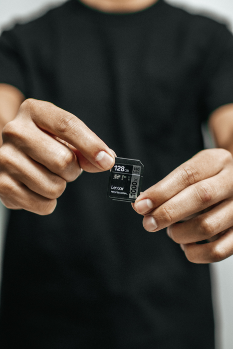 A man holding up a memory card