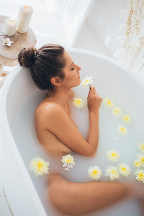 An intimate milk bath photography shoot with flowers