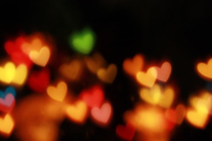 An image full of heart-shaped bokeh circles.