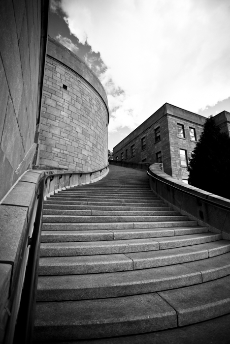 a photo of a stairwell show how to use leading lines photography